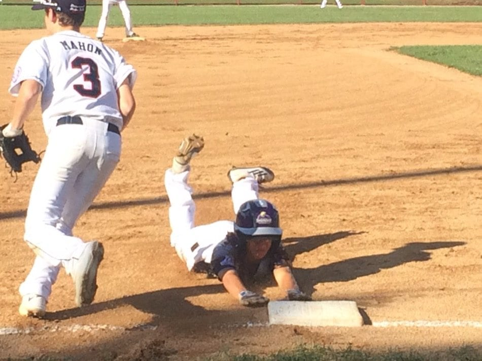 Pear City's Jayton Pang slides into third in the first inning. Pang would score to start the 11-0 rout.