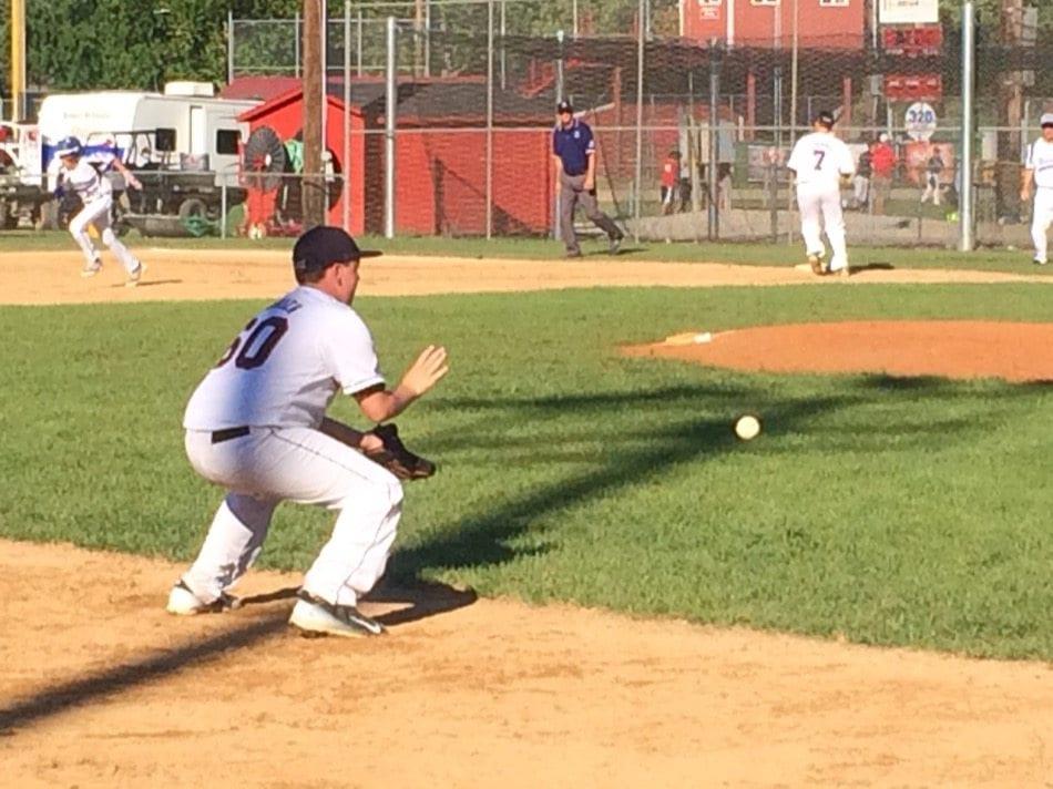 Davenport third baseman Keiran O'Brien starts a double play.