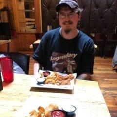 Catfish Guy Peter Robinson eating a catfish dish named after him at Baked.