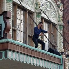 A performer atop the Circa marquee at 1828 3rd Ave., Rock Island.