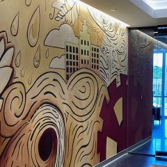 EXCLUSIVE: TBK Bank Opens In Downtown Bettendorf With New Metro Arts Murals